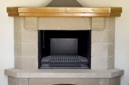 stone fireplace: Brand stone fireplace in the interior of a house.