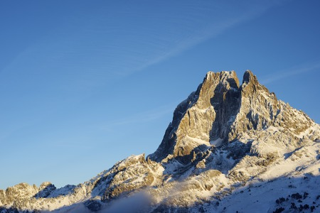 western slope: sunset on the western slope of the peak Midi dOssau, 2884 meters, Ossau Valley, Pyrenees, France