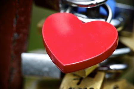 Love padlock on the railing of a bridge photo