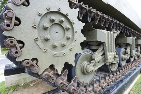 a memorial to fallen soldiers: Close-up of tracks of a M4A1 Sherman tank in Overlord Museum Omaha Beach, Normandy, France.