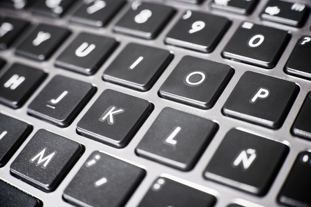 forefront: Forefront of a gray laptop keyboard. Stock Photo