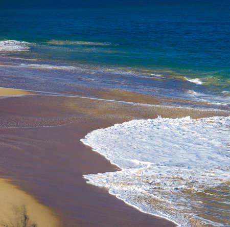 san sebastian: Waves on sandy beach, San Sebastian, Spain. Stock Photo