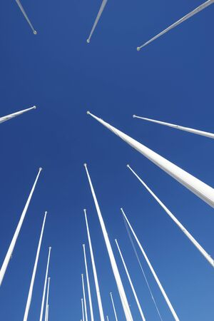 masts: Masts no flag and clear blue sky.