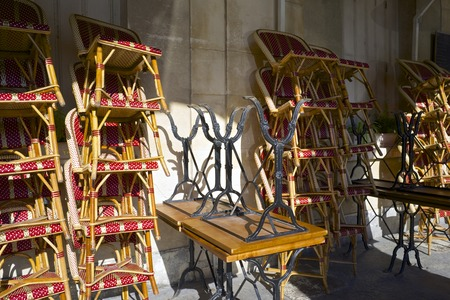 Chairs stacked in a cafe, Paris, France.