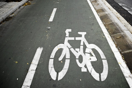 Bike lane sign painted on a street. photo