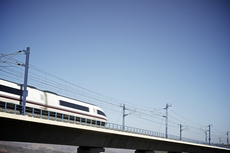 view of a high-speed train crossing a viaduct in Zaragoza Province, Aragon, Spain. AVE Madrid Barcelona. photo