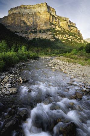 ordesa: Fraucata wall and Arazas river in Ordesa National Park, Pyrenees, Huesca, Aragon, Spain. Stock Photo