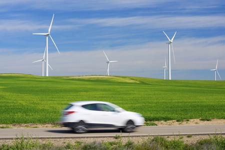 aragon: Windmills for electric power production and car, Zaragoza province, Aragon, Spain.