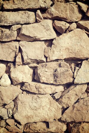 countrified: Background created with stone wall of a rural building