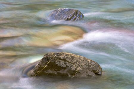Two stones in a river; Pineta Valley; Ordesa and Monte Perdido National Park; Huesca; Spain photo