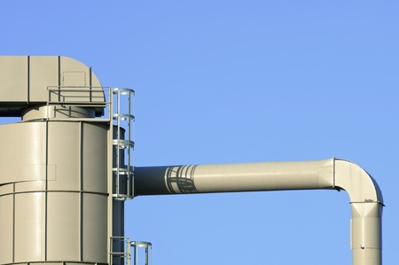 metal pipes: Metal pipes on the facade of a factory. Stock Photo