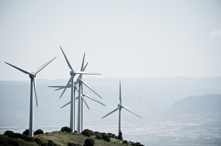 windturbines: group of windmills for renewable electric energy production on a hill, Aras, Navarre, Spain