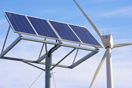 zaragoza: Windmill and photovoltaic panel for energy production, Zaragoza Province, Aragon, Spain. Stock Photo