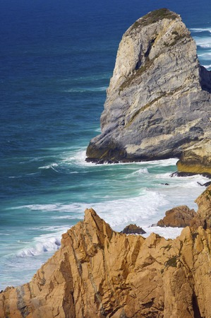 geographical: Wave and stone in Cabo da Roca, Areia, geographical point of western Europe, Portugal. Stock Photo