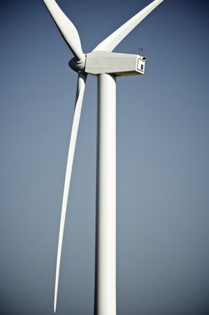windturbine: windturbine for electric energy production with blue sky Stock Photo