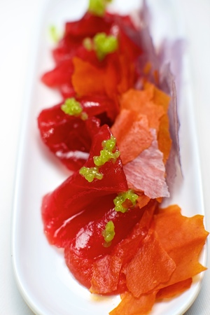 tunny: Red tuna in a small white saucer. Stock Photo