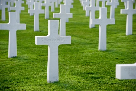 a memorial to fallen soldiers: White crosses in American Cemetery, Coleville-sur-Mer, Omaha Beach, Normandy, France. Stock Photo