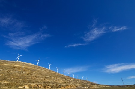windturbines: Windmills for renewable electric energy production, Teruel province, Aragon, Spain. Stock Photo