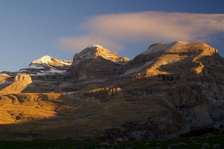 anisclo: Monte Perdido peak (3355m.),Sum de Ramond peak (3254m.) and Punta de Las Olas peak (3002m.), right to left, in Ordesa National Park, Anisclo Canyon, Huesca, Aragon, Spain. Stock Photo