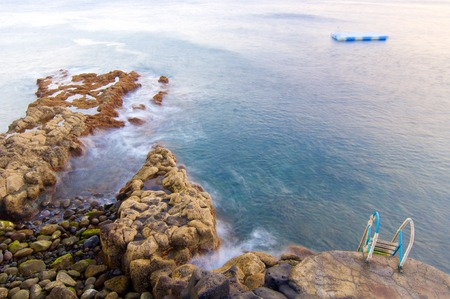 melancholy: Melancholy scene in a pebble beach on Madeira Island, Portugal. Stock Photo
