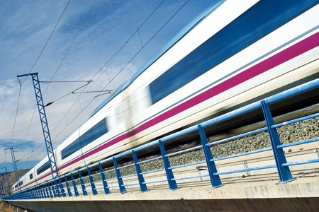 rails: view of a high-speed train crossing a viaduct in Arandiga, Zaragoza, Aragon, Spain. AVE Madrid Barcelona. Stock Photo