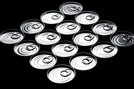 canned food: Closeup of a group of aluminium cans.