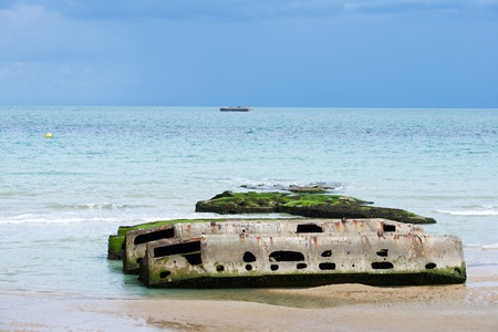 basse normandy: Ruins of harbor built by the Allies in Arromanches, Normandy, France. Stock Photo