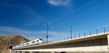 speed: view of a high-speed train crossing a viaduct in Purroy, Zaragoza, Aragon, Spain. AVE Madrid Barcelona. Stock Photo