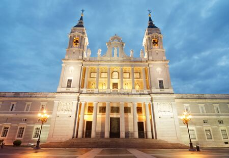 iluminate: Night view of the Cathedral of Santa Maria la Real de la Almudena, located opposite the Royal Palace was built during the IX and XX centuries, Madrid, Spain