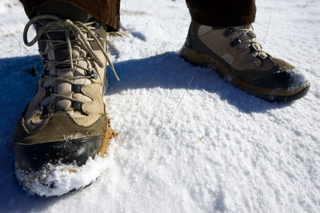 hillwalking: Closeup of hiking boots in the snow.