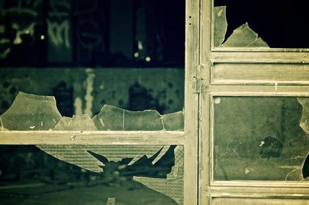windowpanes: Close-up of broken windowpanes. Stock Photo