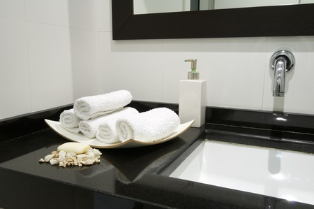 holistic view: view of stacked towels and soap in a modern toilet