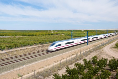 ave: view of a high-speed train crossing a field in Ricla, Zaragoza, Aragon, Spain. AVE Madrid Barcelona. Editorial