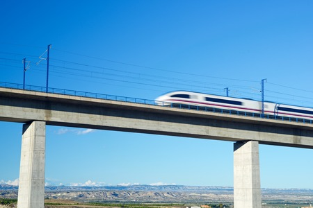 ave: view of a high-speed train crossing a viaduct in Roden, Zaragoza, Aragon, Spain. AVE Madrid Barcelona. Editorial