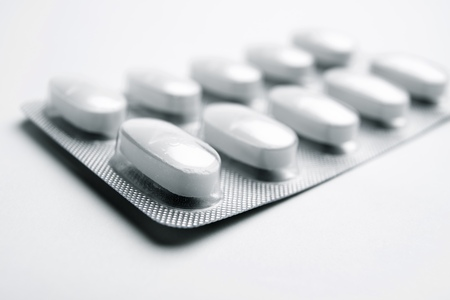 forefront: Forefront of a white medicine pills in blister pack.