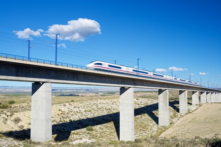 barcelona spain: view of a high-speed train crossing a viaduct in Roden, Zaragoza, Aragon, Spain. AVE Madrid Barcelona. Stock Photo