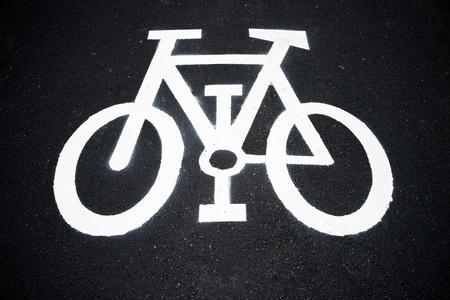 bikeway: Bike lane sign painted on a street.