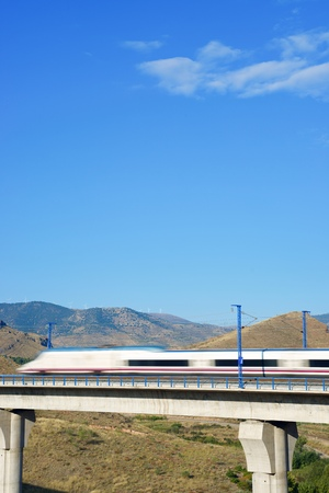highspeed: view of a high-speed train crossing a viaduct in Purroy, Zaragoza, Aragon, Spain. AVE Madrid Barcelona. Stock Photo
