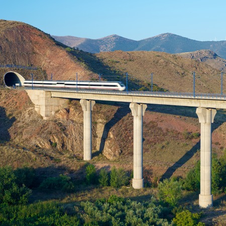 ave: view of a high-speed train crossing a viaduct in Purroy, Zaragoza, Aragon, Spain. AVE Madrid Barcelona. Editorial
