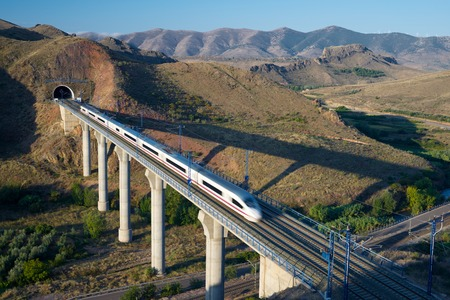 highspeed: view of a high-speed train crossing a viaduct in Purroy, Zaragoza, Aragon, Spain. AVE Madrid Barcelona. Editorial