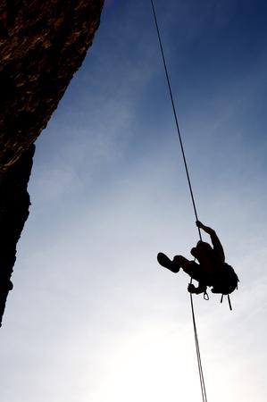 techniek: klimmer aflopende met de techniek van abseilen Stockfoto