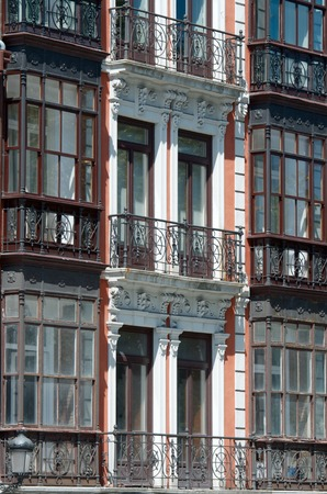 aviles: typical facade with balconies in the old town of Aviles, Asturias, Spain.