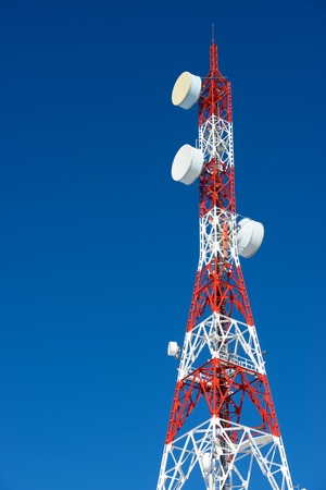telecommunication: Telecommunications tower with clear blue sky.