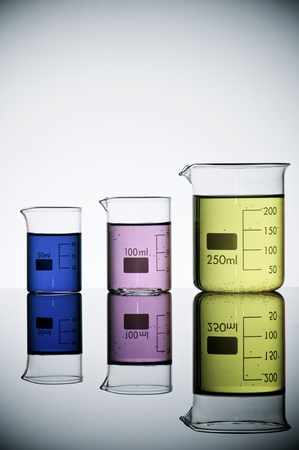 beakers: group of laboratory beakers containing liquid color