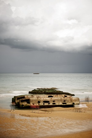 allies: Ruins of harbor built by the Allies in Arromanches, Normandy, France. Stock Photo