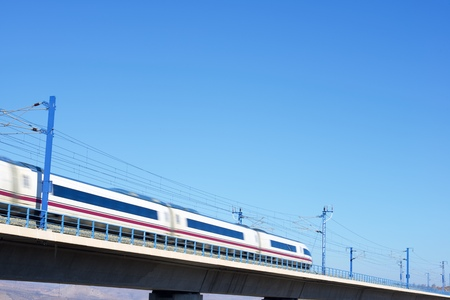 ave: view of a high-speed train crossing a viaduct in Zaragoza Province, Aragon, Spain. AVE Madrid Barcelona. Editorial
