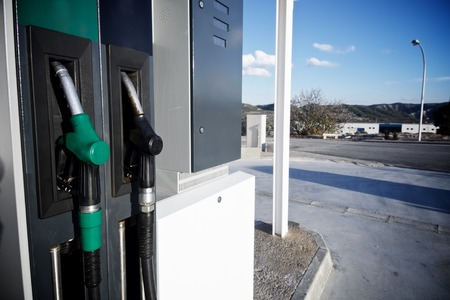 fueling pump: Close hose  spout of a gas station