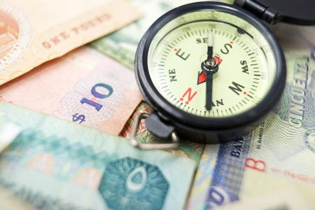 different countries: Compass and banknotes of different countries.
