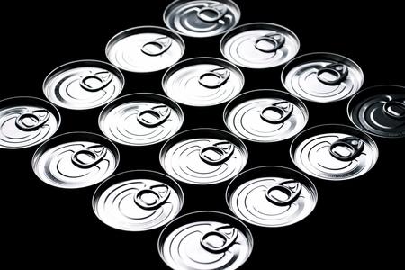 hermetic: Closeup of a group of aluminium cans.