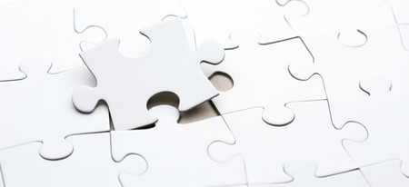 business puzzle: Close up of the pieces of a puzzle